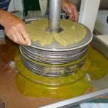 Laying the paste on the mats Monteverde Olives Queensland